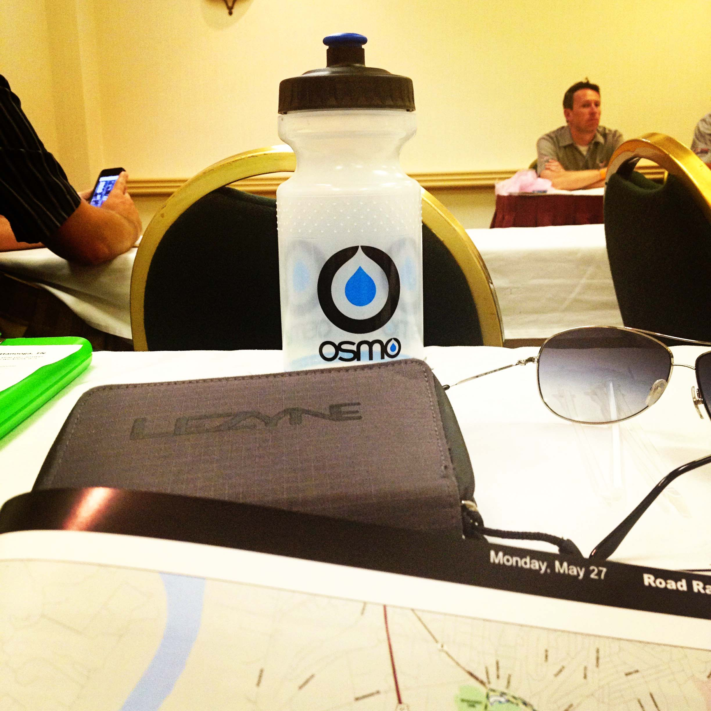 Multitasking: staying hydrated while attending the Manager's Meeting at US Pro Championships