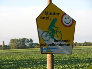 Translation: Drive slowly, schoolchildren riding bikes.