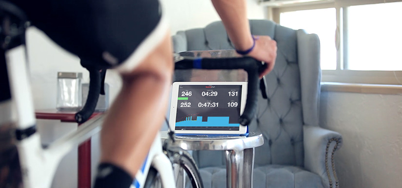 A cyclist is on a bike indoors completing an FTP test