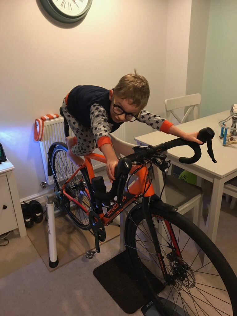 Rob's son, Jack, sitting on the turbo he used for training for bikepacking.