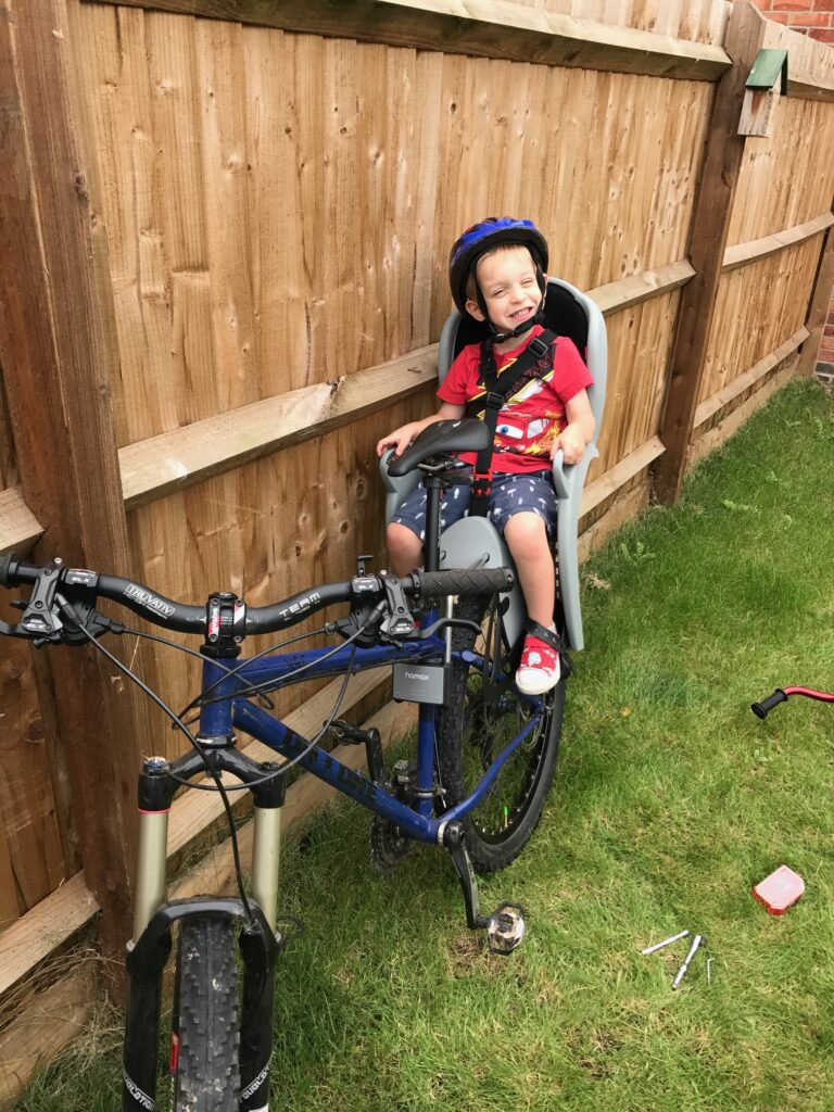 Jack sits on the bike for a ride in which Rob learned that needed training for bikepacking.