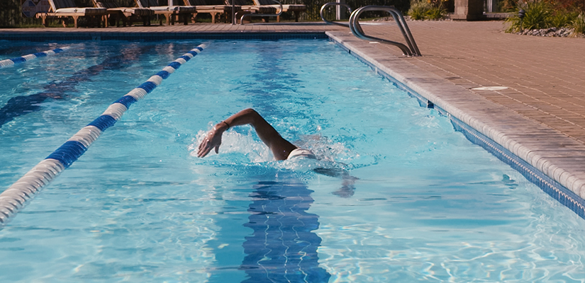 This is a triathlon completing a triathlon swim workout in a pool.
