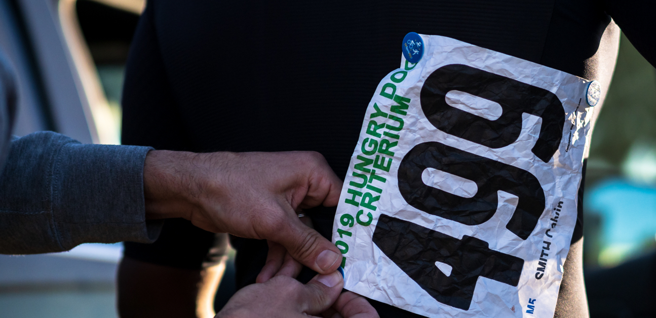 An athlete pins a number on during their first season racing.