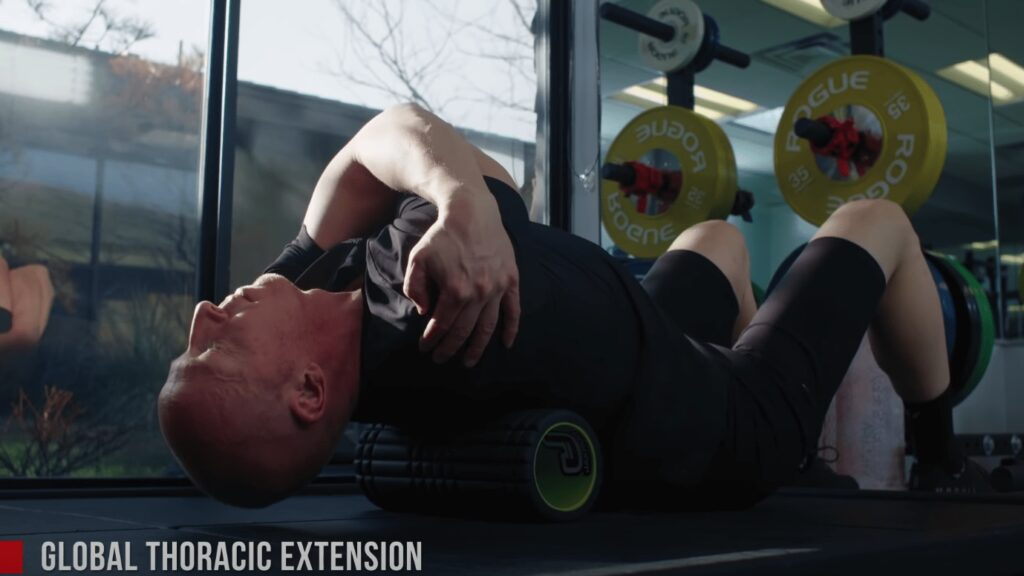 Coach Chad has a muscle roller underneath his upper back during this stretch for cyclists.